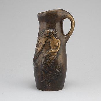 An art noveau bronze jug by Alice Nordin.