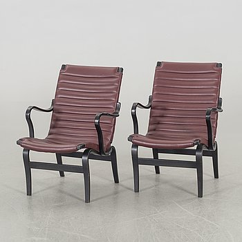 An end of the 20th Century pair of 'Eva' armchairs by Bruno Mathsson for Dux.