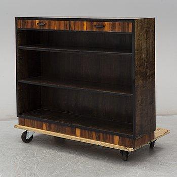 a 1930's stained birch bookshelf.