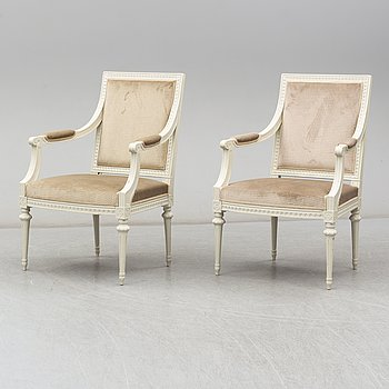 a pair of gustavian style armchairs from the first half of the 20th century.