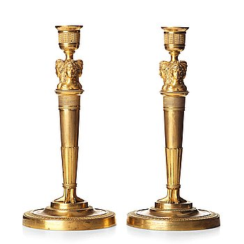 A pair of French Empire early 19th century gilt bronze candlesticks.