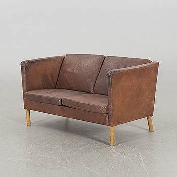 A Leather sofa from Fritz Hansen Denmark later part of the 20th century.