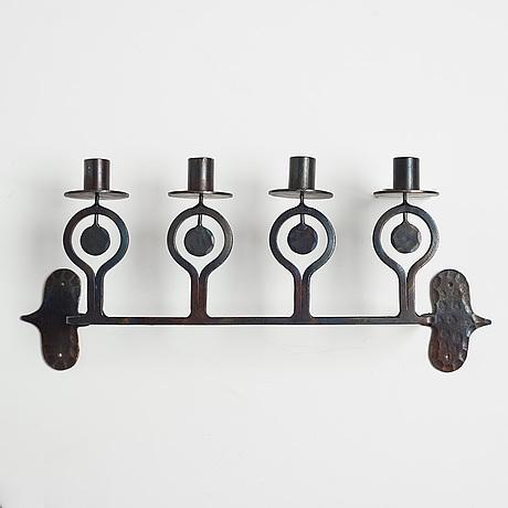 Bertil vallien, a wrought iron wall candelabrum from boda smide, 1960's