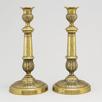 A pair of Empire bronze candlesticks, first half of the 19th century.