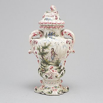 A Rococo faiance vase with cover, mid 18th century.
