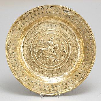 A german brass christening plate,  probably Nuremberg, 16th century.