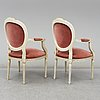 A pair of mid 20th century gustavian style armchairs