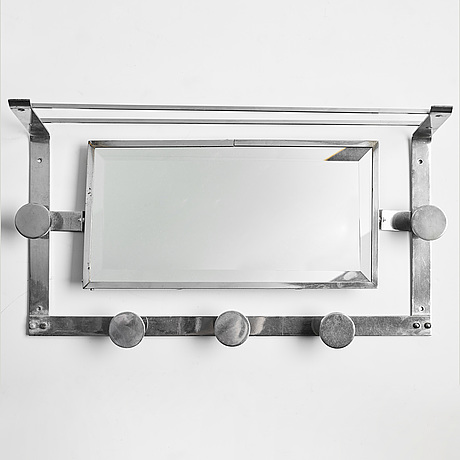 A mid 20th century shelf with mirror