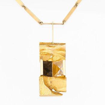 "A BJÖRN WECKSTRÖM NECKLACE, ""Narcissos"", 14K gold, rock crystal, smoky quartz. Lapponia 1965."