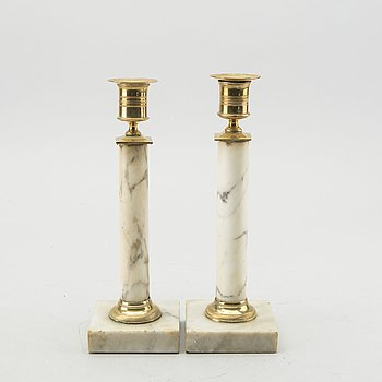 A pair of Late Gustavian marble candle sticks.