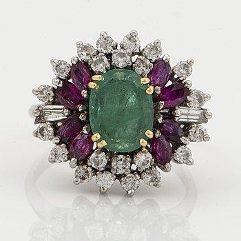 Emerald, navette-cut ruby and trapets and brililant-cut diamond ring.