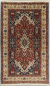 An old Tabriz carpet ca 256 x 151 cm.