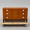 A walnut veneered chest of drawers, 1930's.