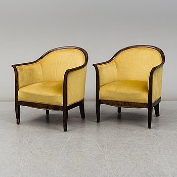 A pair of stained birch easy chairs, 1920's.
