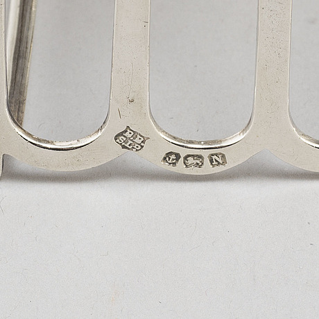 A set of four silver toastracks, barker brothers birmingham 1936