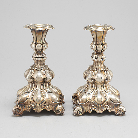 A pair of silver candle sticks.