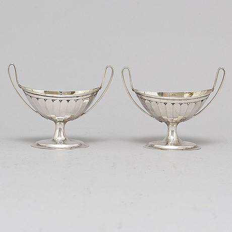 A pair of parcel-gilt empire silver salt cellars, 19th century.