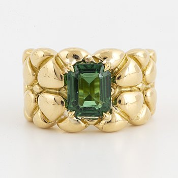 Emereld-cut green tourmaline and gold ring.
