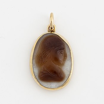 Carved agate pendant.