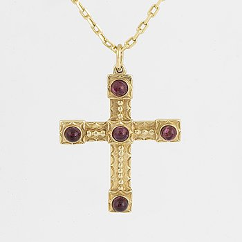 Gold and cabochon-cut garnet cross necklace.