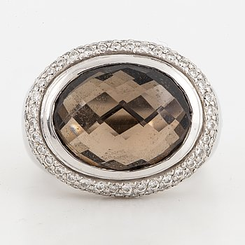 Checker-cut smoky quartz and brilliant-cut diamond ring.