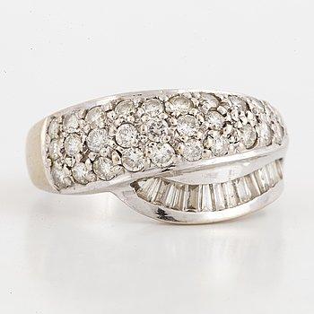 Brillian- and baguette-cut diamond ring.
