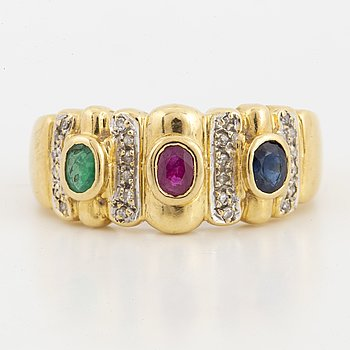 Emerald, sapphire, ruby and small diamond ring.