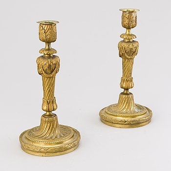 A pair of 19th century brass candlesticks, probably France.