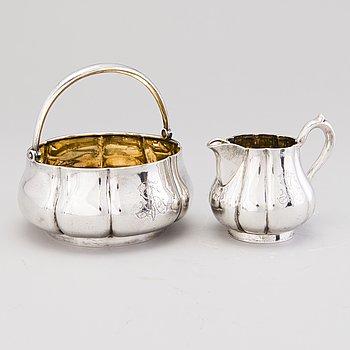 A silver bowl with handle and a silver cream jug, assay marks Yakov Nikolayevich Lyapunov, Saint Petersburg 1897-1903.