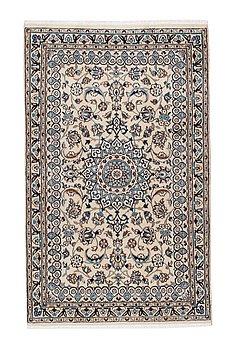 An old part silk Nain carpet ca 187 x 116 cm.