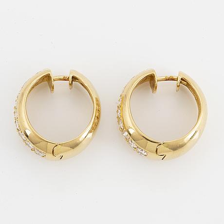 18k gold and brilliant-cut diamond earrings.
