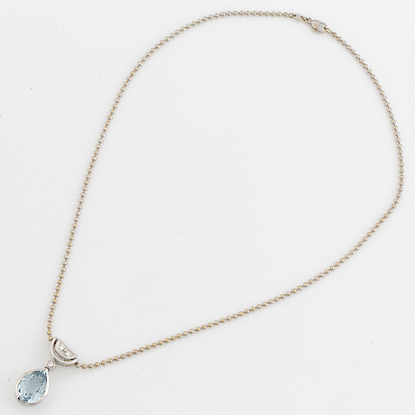 White gold chain and pendant with pearshaped topaz and brilliant-cut diamonds.