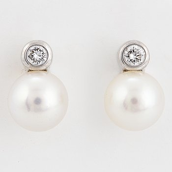 White gold cultured pearl and brilliant-cut diamond earring.