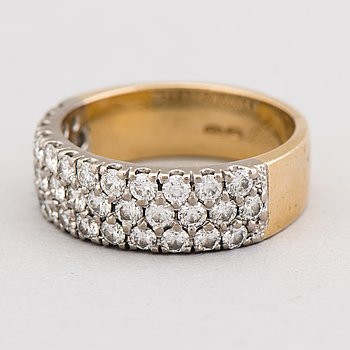 A RING, brilliant cut diamonds, 18K gold and white gold.