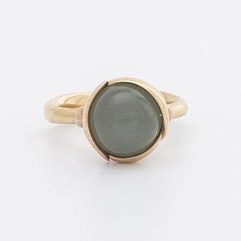 "OLE LYNGGAARD, RING, design Charlotte Lynggaard  ""Lotus"" no 2, 18k gold w cobochon-cut aquamarine."