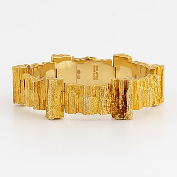 An 18K gold bracelet designed by Björn Weckström for Lapponia.