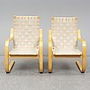 Alvar aalto, pair of model '406' armchairs for artek, late 20th century.