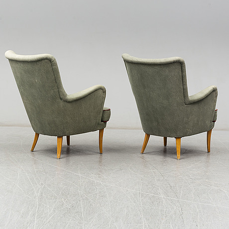 A pair of swedish easy chairs, mid 20th century.
