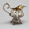 A russian parcel-gilt silver creamer,  1842, probably moscow.