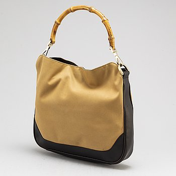GUCCI, a canvas, leather and bamboo bag.