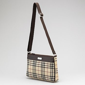 BURBERRY, a plaid canvas cross body bag.