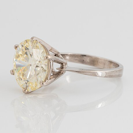 A 14k gold ring set with an old-cut diamond 6.70 cts quality k vvs 2 according to an igl certificate.