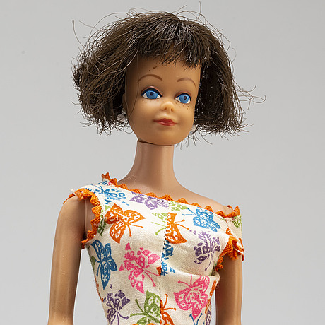 A set of three 1960's barbiedolls with accessories, mattel