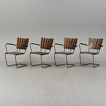 Four tubular steel and pine garden chairs, mid 20th Century.