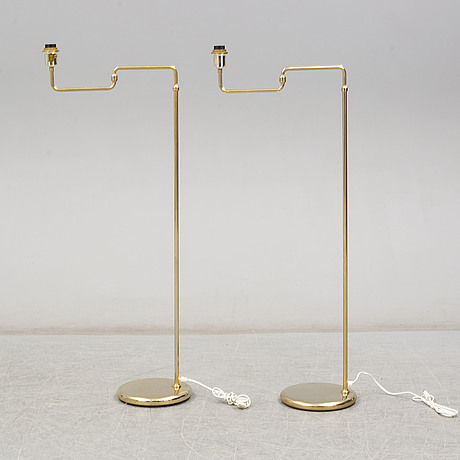 A pair of brass standard lights from reijmyre armaturfabrik, late 20th century