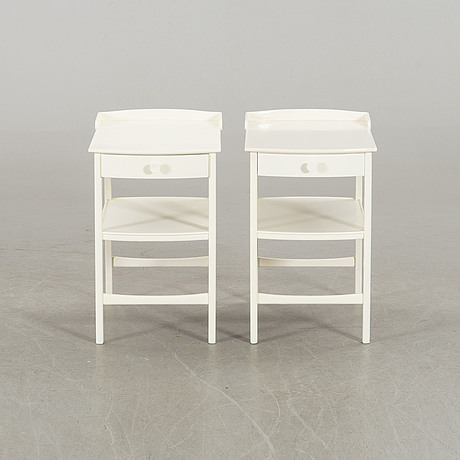 A pair of carl malmsten bedside tables.