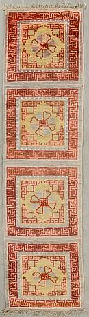 An antique chinese prayer rug ca 250 x 67 cm.