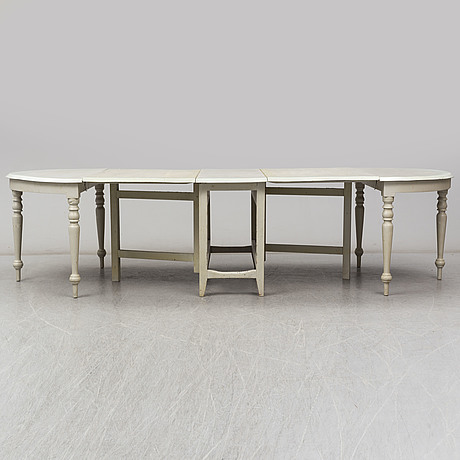 A 19th century dining table in three parts.
