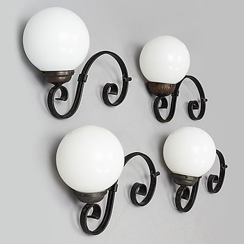 a set of four wall lamps from the second half of the 20th century.