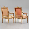 A pair of gustavian late 18th century armchairs.
